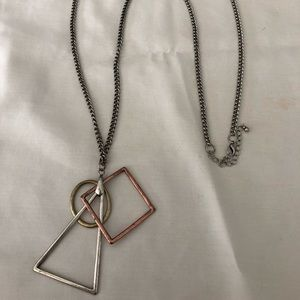 Jewelry - A long brushed silver geometric necklace